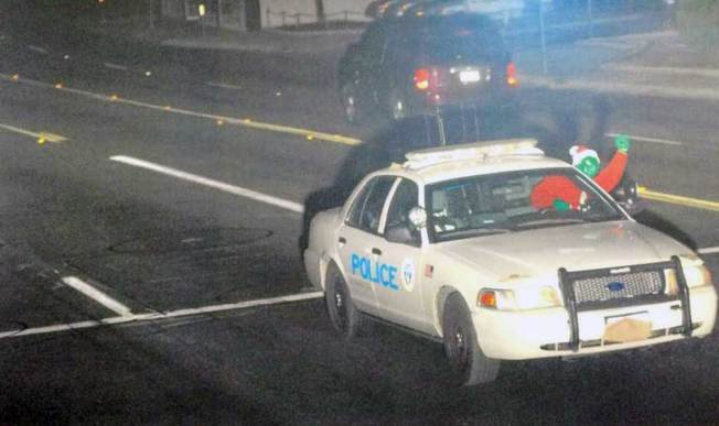 Lawsuit Photo Shows 'Grinch' in Patrol Car Run Red Light