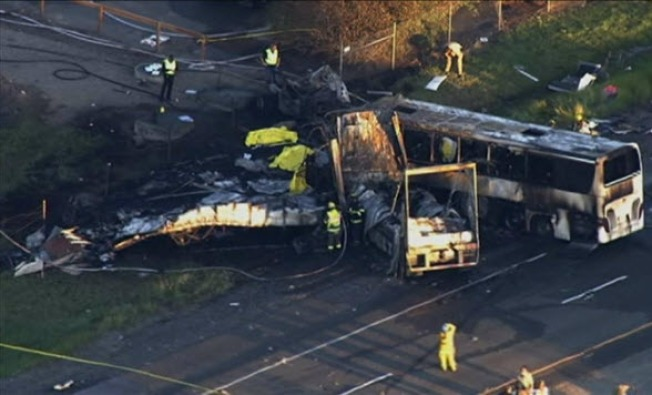 Barrier Rails, Double Trailer Safety Debated After Deadly Bus Crash