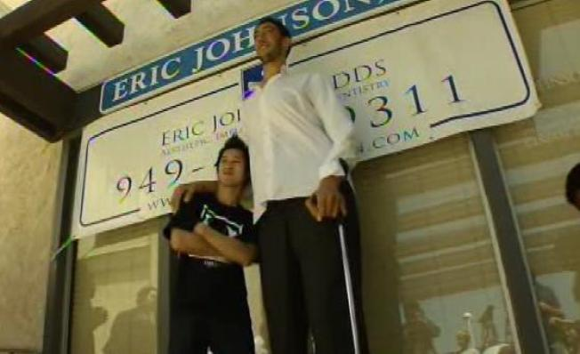 World's Tallest Man Visits OC for Dental Makeover