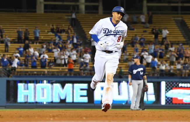 check out 5f06f 766be Manny Machado Homers in Dodger Stadium Debut, But Dodgers ...