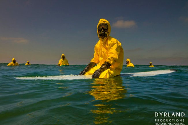 Photographer Aims to Educate About Ocean Pollution with 'Hazmat Surfing' Pictures