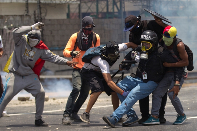 Venezuela Protests: Hospital Tear-Gassed, Chaos Ensues as Protests Intensify