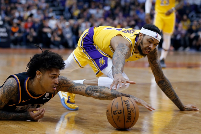 Lakers' Faint Playoff Hopes Eclipsed by Suns in Baffling Loss