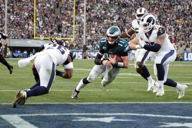 Carson Wentz rebounds from early interception as Eagles tie Rams