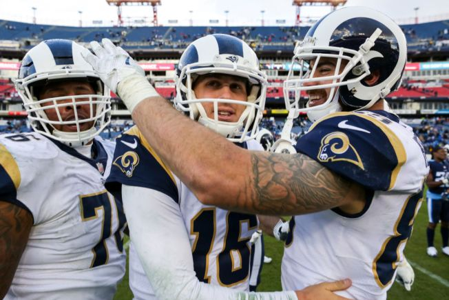 Rams clinch 1st NFC West title since '03, beat Titans 27-23