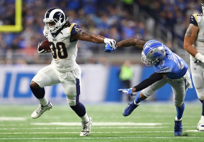 Rams Beat Lions 30-16, Clinch NFC West Title