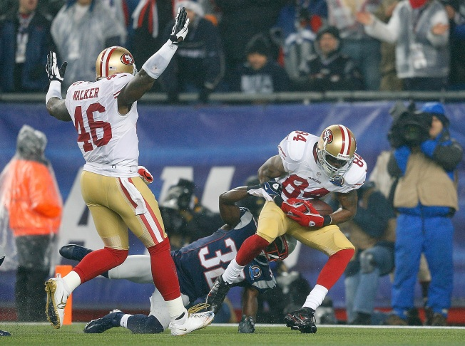 Niners Win Wild Duel With Patriots