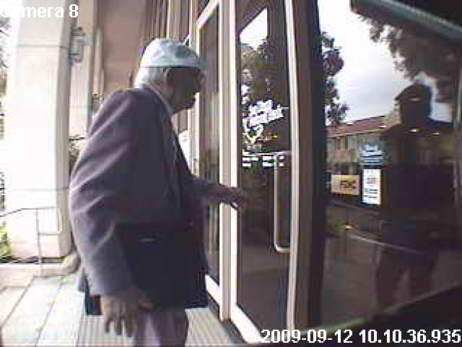 Well-Dressed Elderly Gent With Oxygen Tank Robs Bank