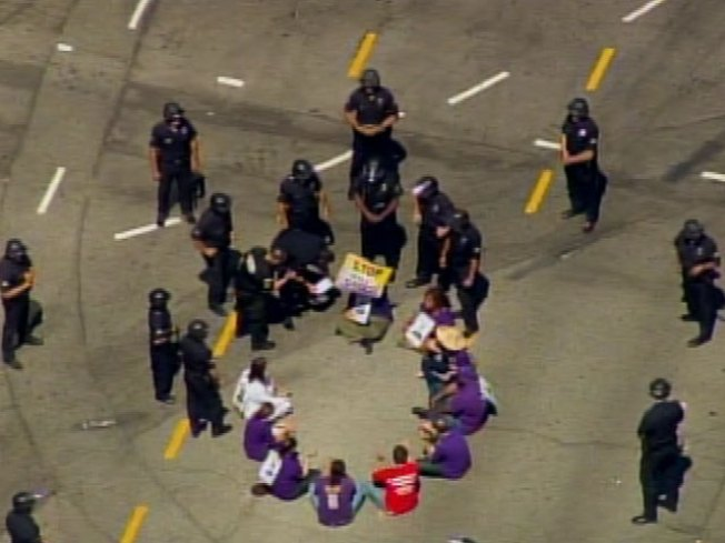 Janitors' Protest Leads to 13 Arrests
