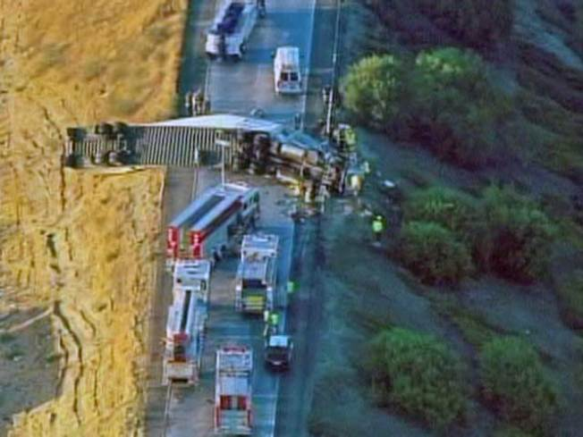 Crews Remove Driver From Overturned Big Rig
