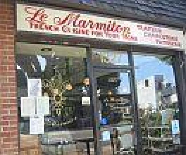 """The Shutter:  """"Le Marmiton est Ferme,"""" reads..."""