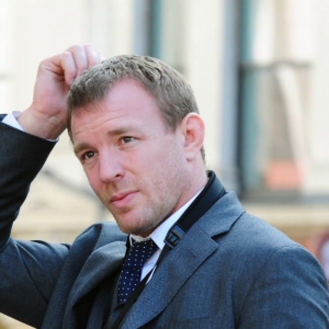 Guy Ritchie Meets Up With Madonna To Pick Up His Children For Christmas