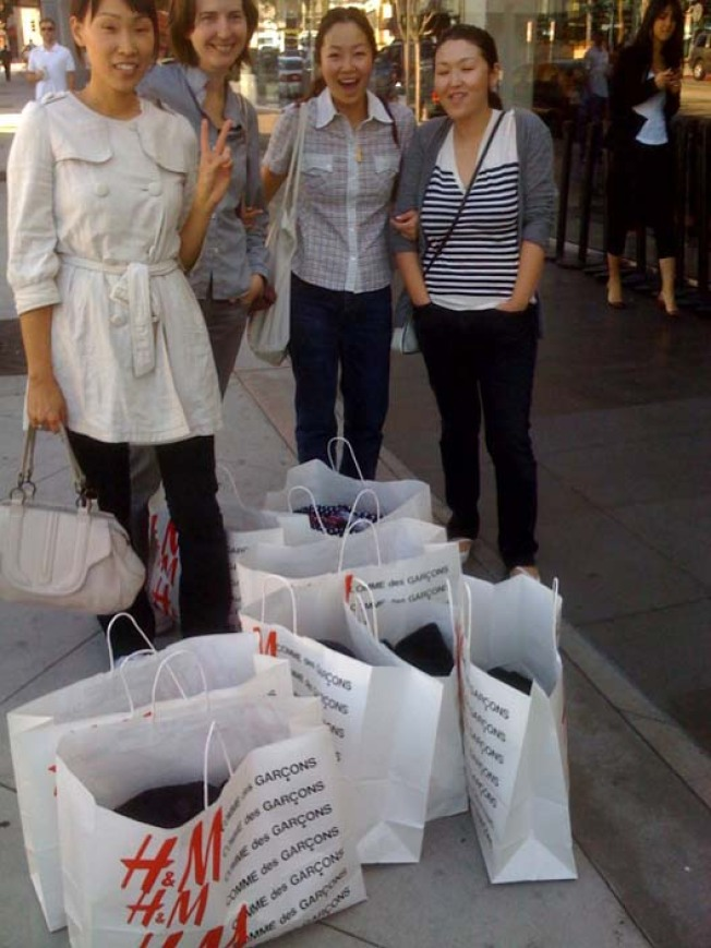 Happy Spending! Comme des Garcons H&M Shoppers All Smiles