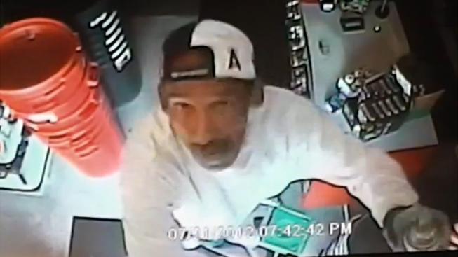 Long Beach Hardware Store Burglar Caught on Video Spraypainting Security Camera