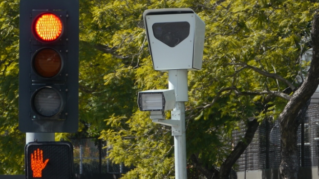 City Will Continue to Collect Fines for Existing Red-Light Camera Tickets