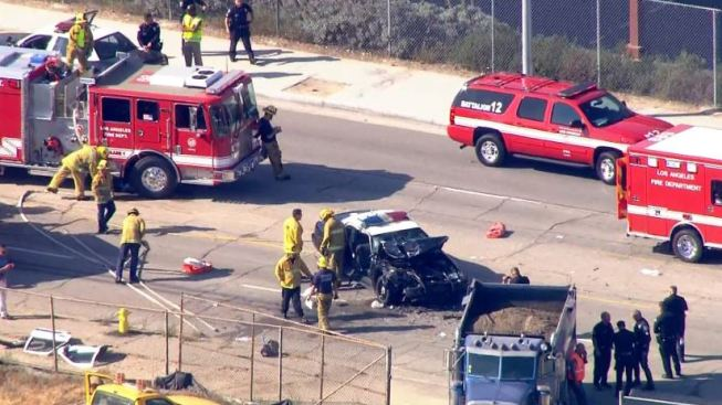 Two School Police Officers Critically Injured in Collision With Dump Truck