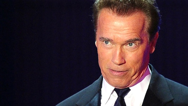 Arnold Takes Wardrobe Shot at Maria