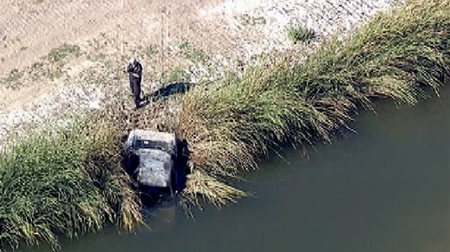 Body Discovered in Burned Car That Is Partly Submerged in Irvine Creek