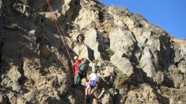 Lifeguards Rescued While Trying to Help Stranded Hiker on Cliff