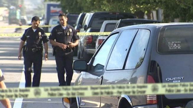 Crash Victim Pinned Between Vehicles Was Changing Shoes Behind Minivan