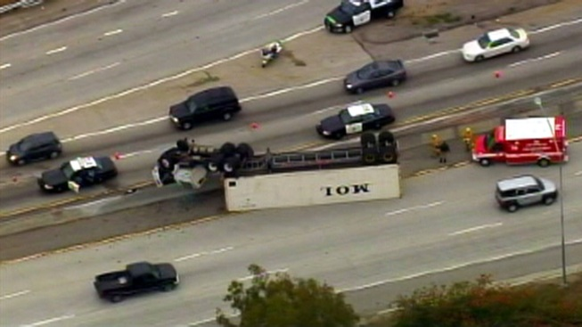 Big Rig Overturns at 91 Freeway Transition to 110 Freeway