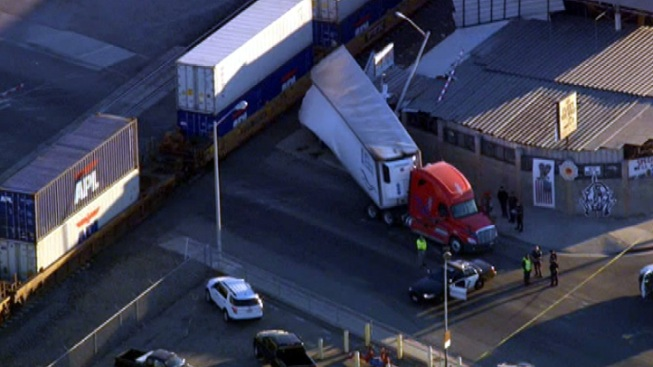 Freight Train Collides With Big Rig Trailer in Montebello