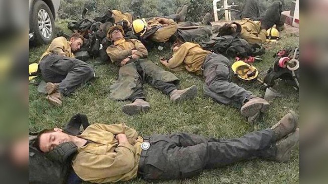 Photo of Exhausted Firefighters Working 24-Hour Shifts Sleeping Outside Goes Viral