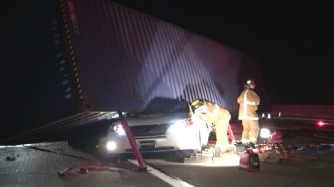 Driver Rescued From Lexus With Big Rig Trailer on Roof
