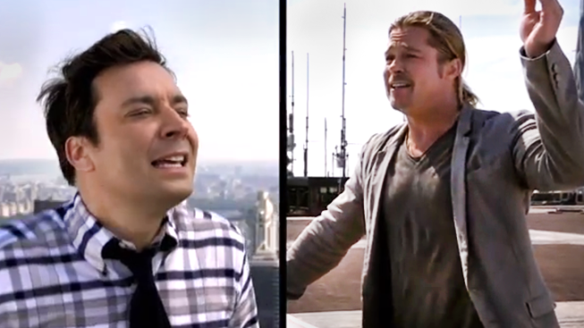 pitt challenges fallon to double yodel from nyc roof nbc
