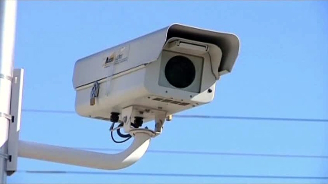 Red-Light Cameras on Road Back to Council