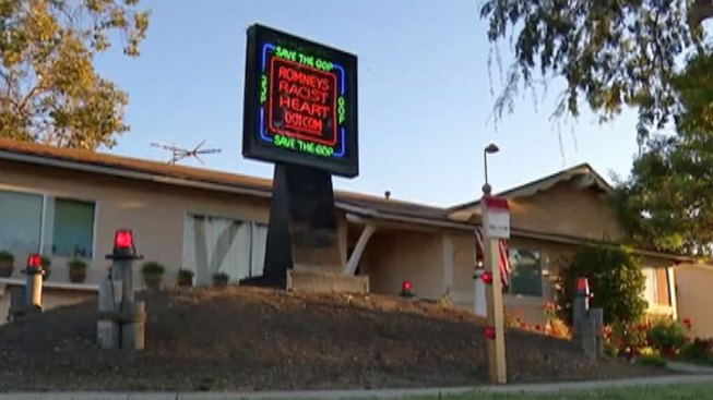 Flashing Neon Sign Targets Romney, Alleges Racism