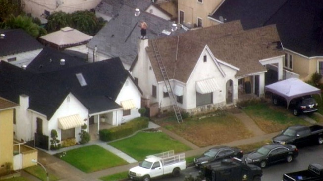 Alleged Burglar Perched Atop Roof in East LA Standoff Comes Down