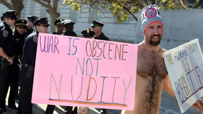 Police Detain Four Naked Protesters on First Day of Nudity Ban