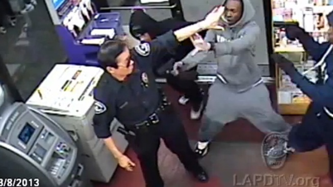Caught on Video: Security Guard Held at Gunpoint in Liquor Store Heist