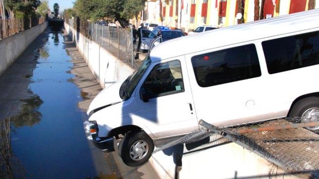 Crash Sends Child-Filled Van Hanging Over Edge of Wash