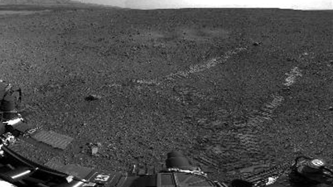 Rover Curiosity Leaves Wheel Tracks on Mars During Test Drive