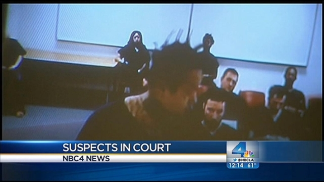 Two suspects in the Northridge quadruple murder case were scheduled to appear in court Wednesday for unrelated cases. Toni Guinyard reports for the NBC4 News at Noon on Dec. 19, 2012.