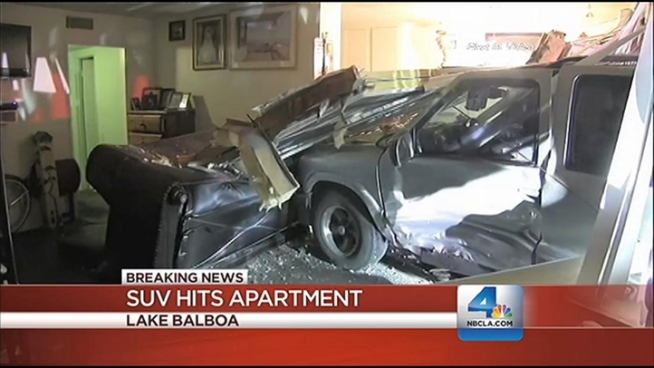 The vehicle hit a building, crashing into an apartment on Vanowen Street in Lake Balboa, on Saturday night. Robert Kovacik had details on the NBC4 News at 11 p.m. on Feb. 2, 2013.