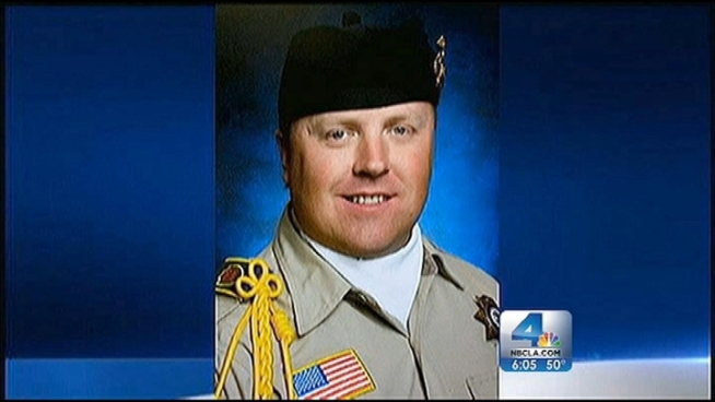 A vigil was held Tuesday evening for Detective Jeremiah MacKay, who died last week in a gun battle with an ex-LAPD officer bent on revenge killings of police officials. Beverly White reports from Yucaipa for the NBC4 News at 6 p.m. on Feb. 19, 2013.