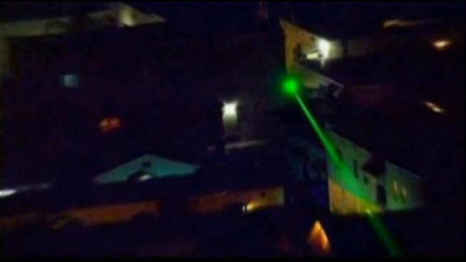 Los Angeles Police use a rare high-flying sting to catch the people who were pointing lasers at their helicopters.  They arrested two suspects and police think they may have been targeting jetliners too.