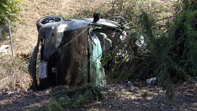 A South Gate woman could face charges in the single-car crash that left two of her young children dead.