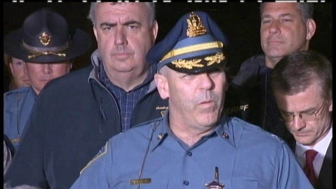 Boston bombing suspect taken alive after lengthy manhunt.  NBC's Jay Gray reports.