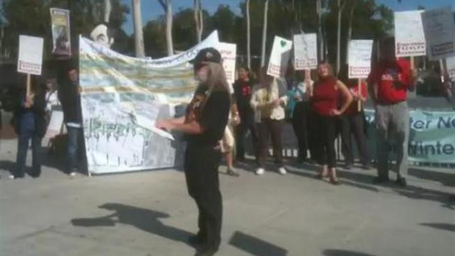 Faculty at California State University, Dominguez Hills march on campus Tuesday, giving information of the Nov. 17 California Faculty Association strike to be held on CSU Dominguez and East Bay campuses.