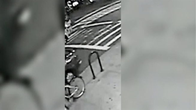 Police are looking for the woman seen in this surveillance video in connection with a deadly subway push in Queens.