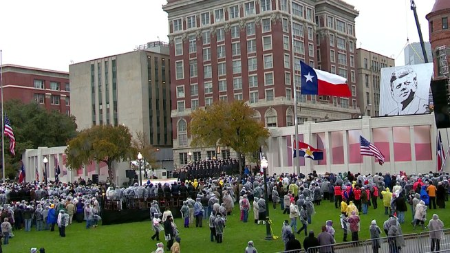 50 years after an assassin's bullet took President John F. Kennedy's life, thousands gathered in Dallas' Dealey Plaza to remember.