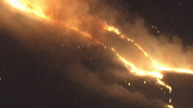 A blaze broke out at about 9 p.m. Tuesday night near a Palmdale residential development and quickly burned up hillsides. Within two hours, it was holding at 250 acres, but Los Angeles County Fire Department officials said wind would be a crucial factor in putting the blaze out completely. Alex Calder reports from NewsChopper4 and Janet Kwak from Palmdale for the NBC4 News at 11 p.m. on July 3, 2012.