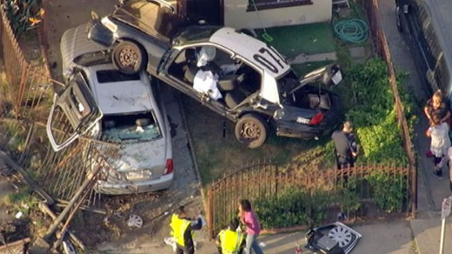 An LAPD cruiser plowed through a fence and landed on top of a car in someone's front yard.  Beverly White reports from South Los Angeles for the NBC4 News at 11 p.m. on Oct. 12, 2012.
