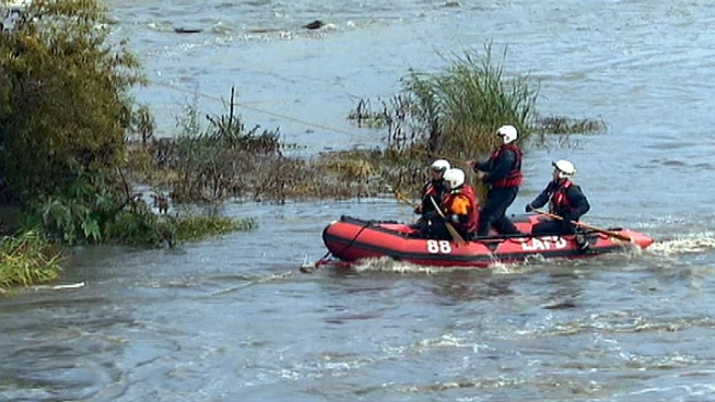 An LAFD firefighter-rescue team pulls a man trapped in the LA River Monday, Dec. 24, 2012 in the Glendale area. Raw Video