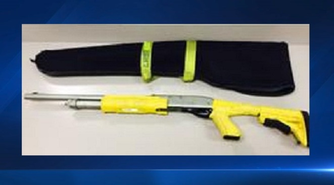 Yellow Shotgun That Takes Lethal And Non Lethal Ammunition