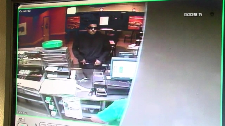 Watch: Robber Takes Cash Directly From Subway Register